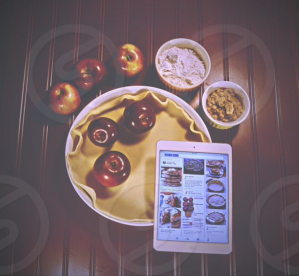 Overhead of tablet and apple pie ingredients photo