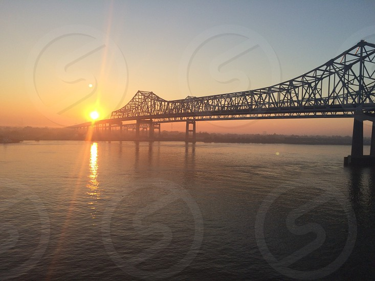 Sunrise over the Mississippi River in New Orleans Louisiana  photo