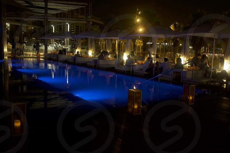 Lifestyle luxury travel Poolside lounge nightlife   photo