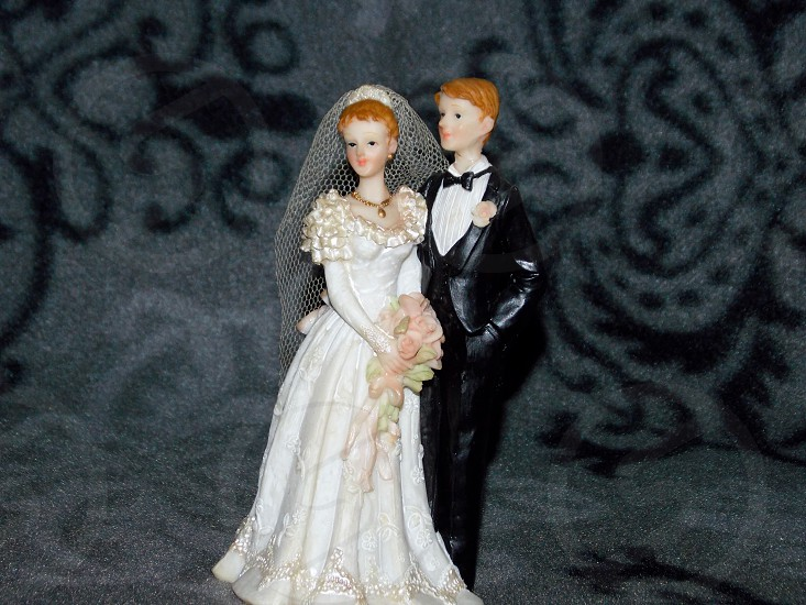 bride and groom ceramic figure photo