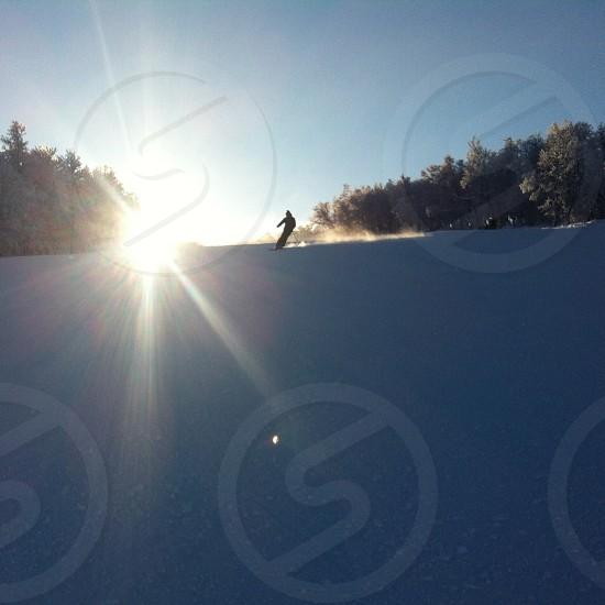 man skating on snow silhouette  photo