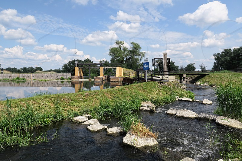 Havel river in summer. historical needle weir with a fish ladder. (Brandenburg Germany).  photo