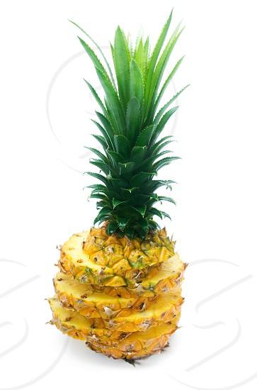ripe vivid pineapple sliced isolated over white background photo
