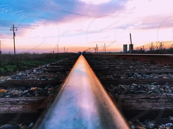 train tracks under sunset photo