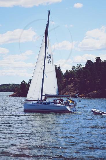 Sailing sailing boat  coastal coast wind summer activity vacation summer sail floating photo