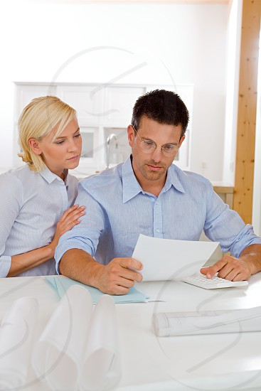 Couple at Home Budgeting sitting on Table photo