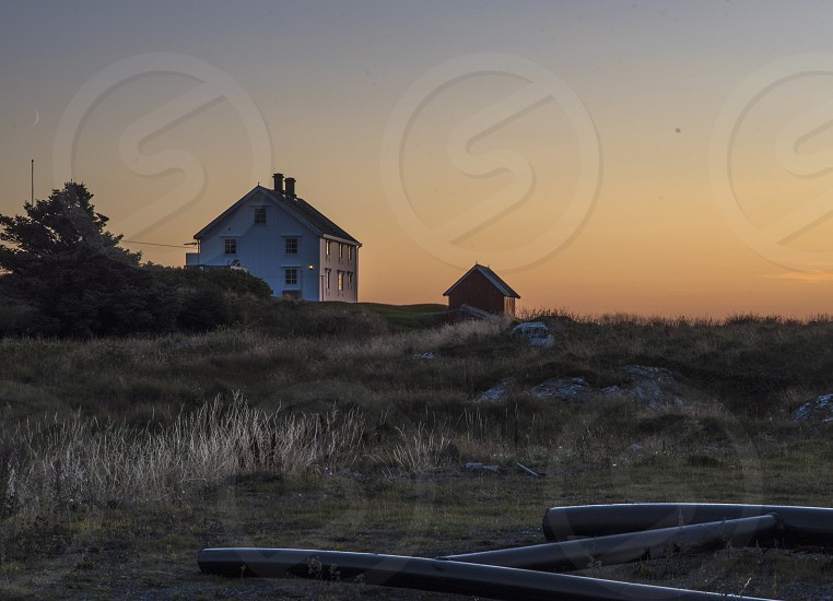 Autumn in a quiet fisher village in Norway sea landscape sunset photo
