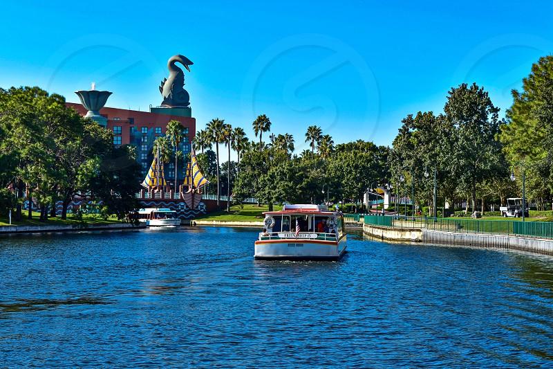 Orlando Florida. February 09 2019 Taxi boat sailing on lake on cloudy sky background at Lake Buena Vista area (6) photo