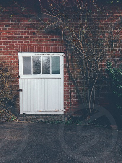 white wooden door is close photo