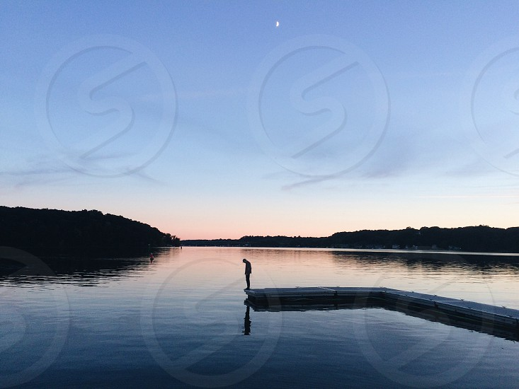 Lake reflection sunset silhouette person photo