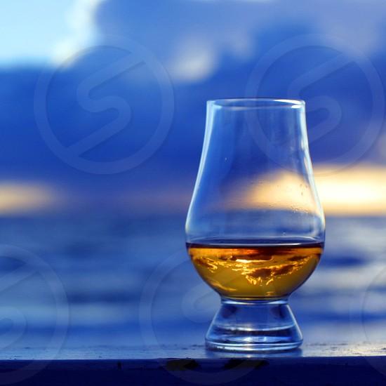 Whisky glass captured at sunset - 2. photo