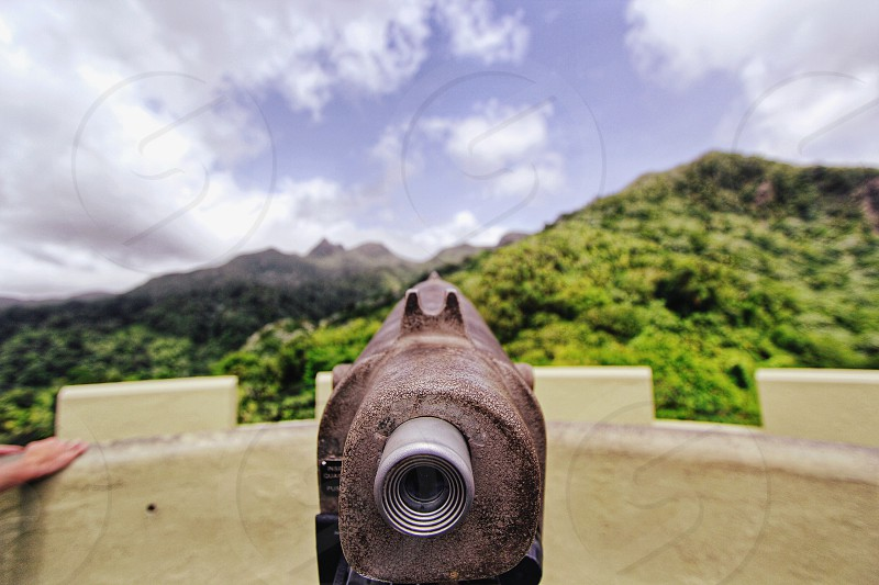 selective focus photographed of rifle aiming mountain photo