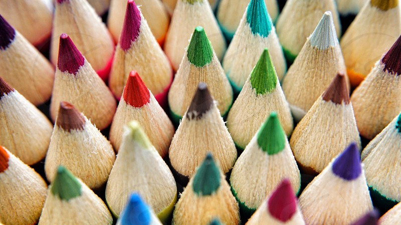red pink green white brown purple and blue wooden color pencils photo
