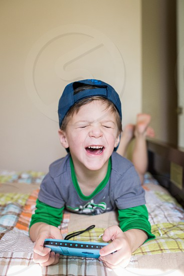 boy happy toddler toddler boy excited funny face silly hat photo