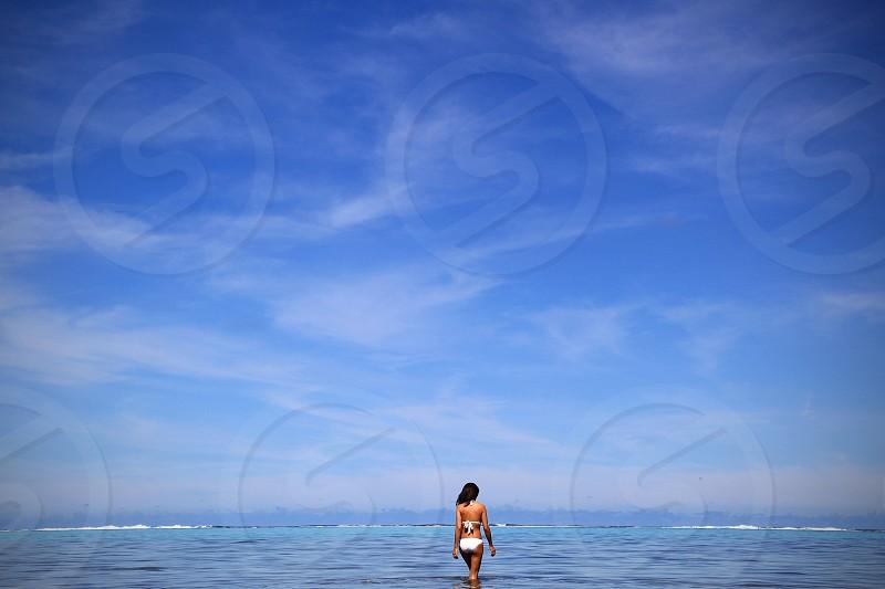 woman walking on sea photo