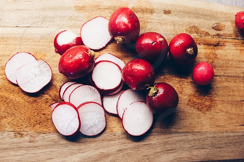 Radishes circles vegetables raw growth harvest cooking cutting board  cutted  red round photo
