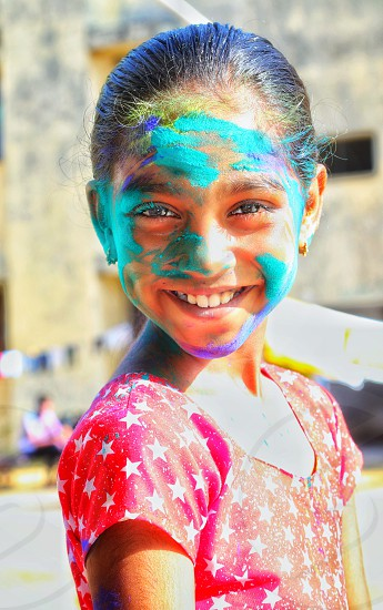 A happy girl celebrating holi  photo