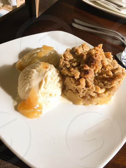 Home made apple crisp and vanilla bean ice cream  photo