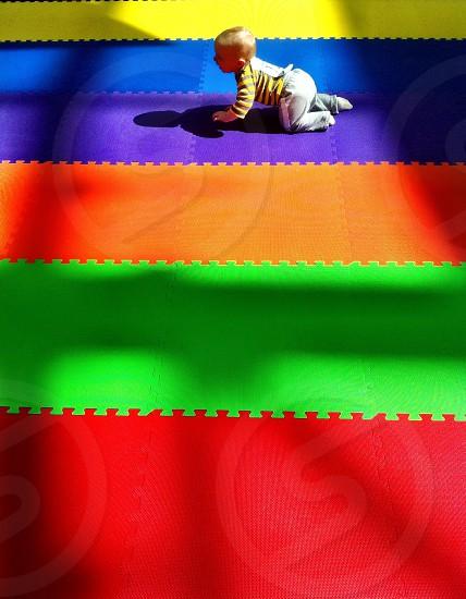 multicolored puzzle mat photo