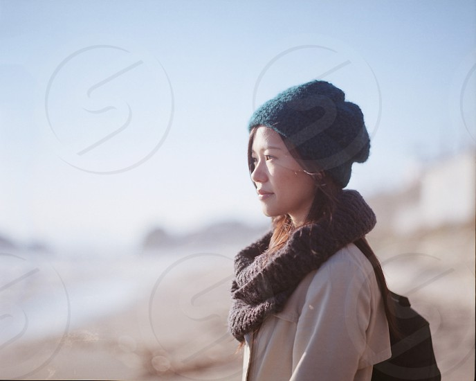 woman in brown scarf  photo