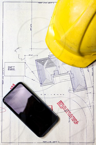Hard hat hat hammer nails blueprint plans drawing planning construction future project property proposal smartphone cell phone mobile technology  photo