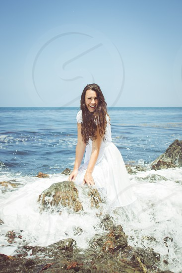 Girl splashed by waves. photo