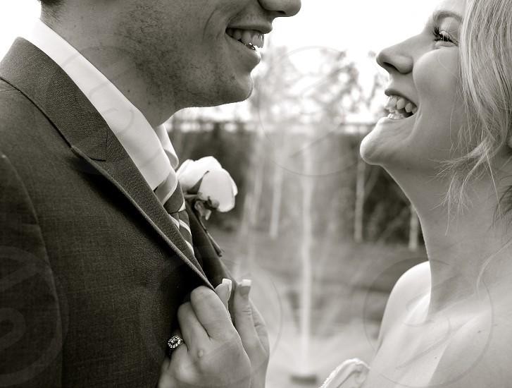 man and woman smiling at wedding photo