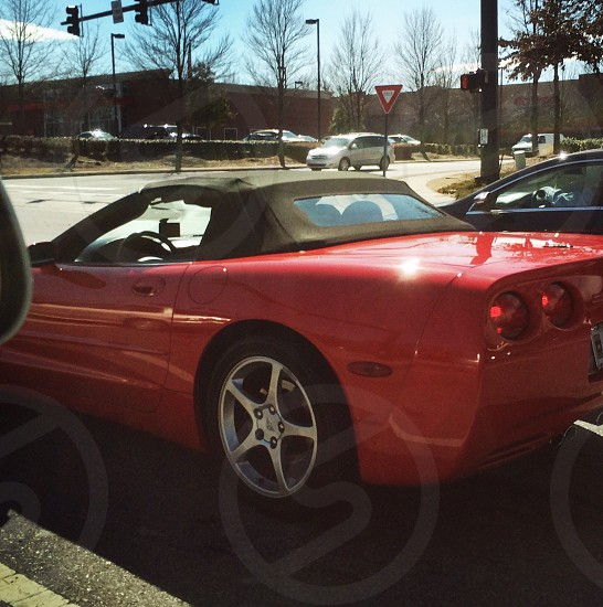 red sports coupe on road during daytime photo