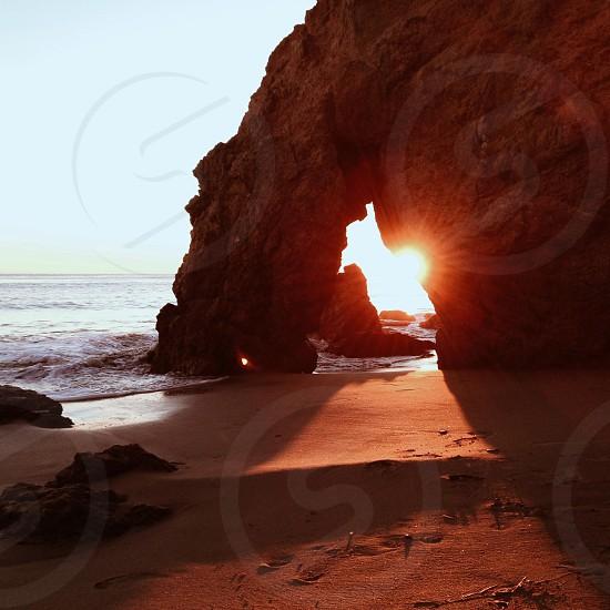 sunset view through a rock mountain photo