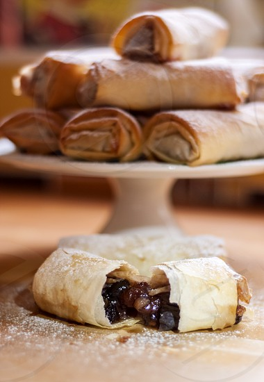 Sweet mince rolls on a cake stand photo
