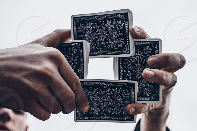 Magician doing a card trick. photo