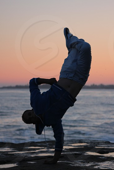man doing hip hop move with hoodie photo