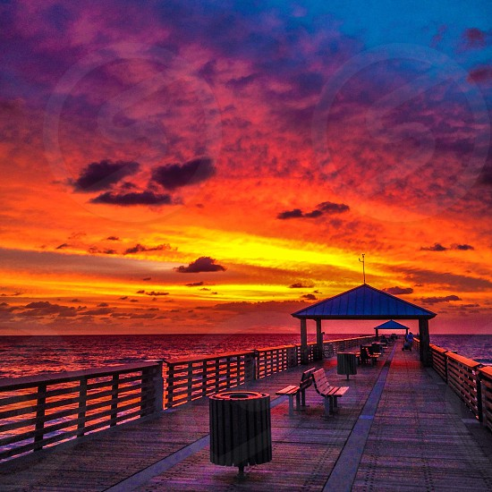 Juno Beach pier sunrise photo