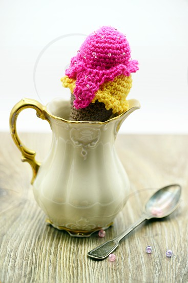 crochet ice cream cone of wool on an antique sugar box photo