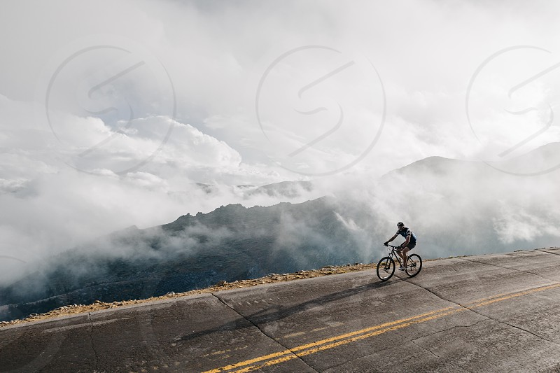 cyclist bicycle riding on road photo