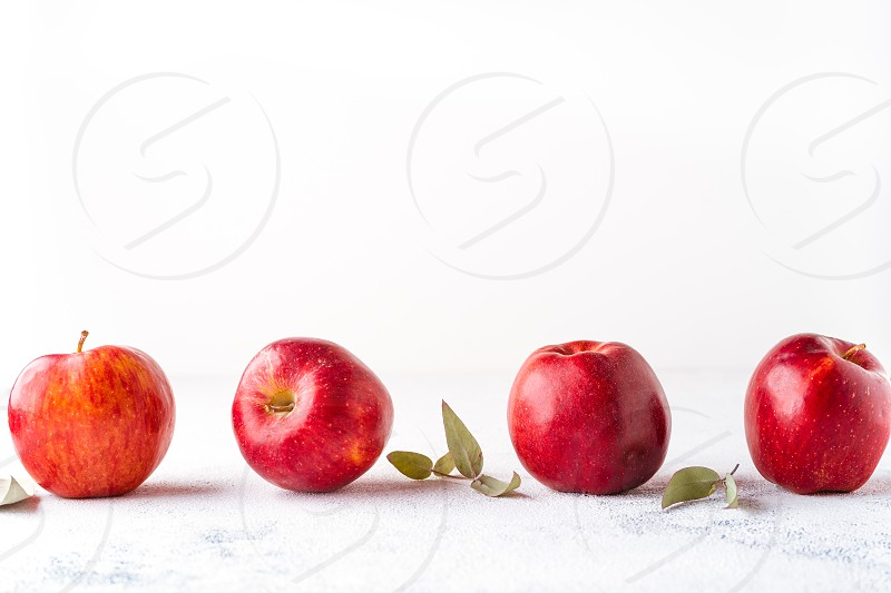 Red apples on a white background photo
