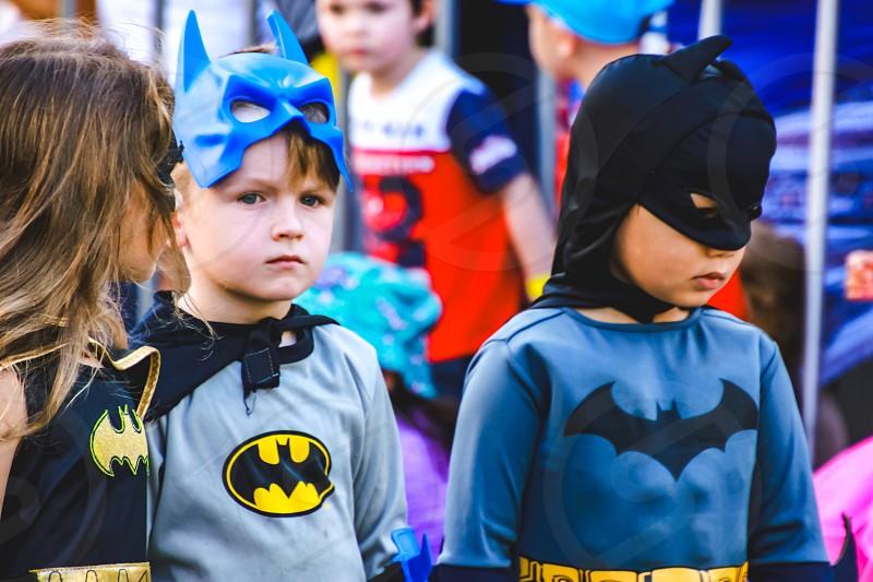 children wearing superhero costumes batman cosplay photo