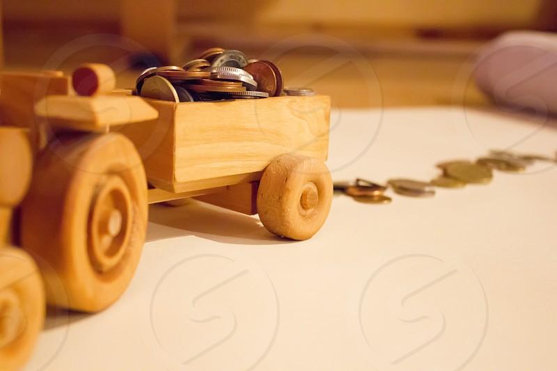 Wooden car full of money photo