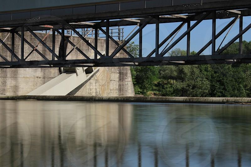 black steel bridge on water reservoir photo