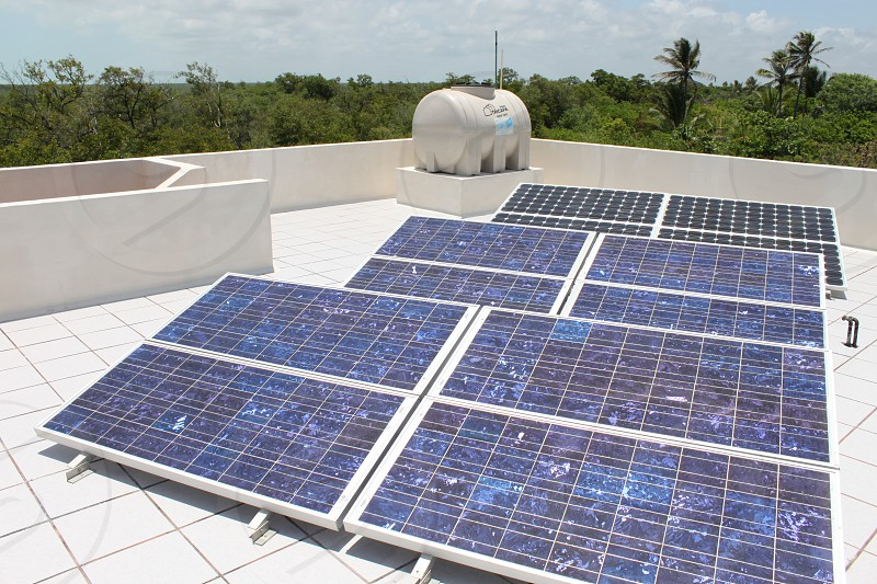 Solar panels on white tile roof photo