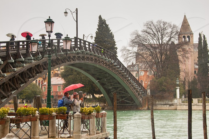 Pedestrian bridge on a rainy day in Venice Italy  photo