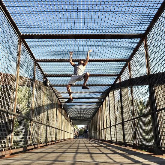 Exercise man urban bridge climbing photo