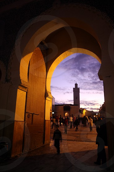 The blue Gate at the Bab Bou Jeloud in the old City in the historical Town of Fes in Morocco in north Africa. photo