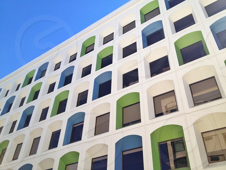 white green and blue building photo