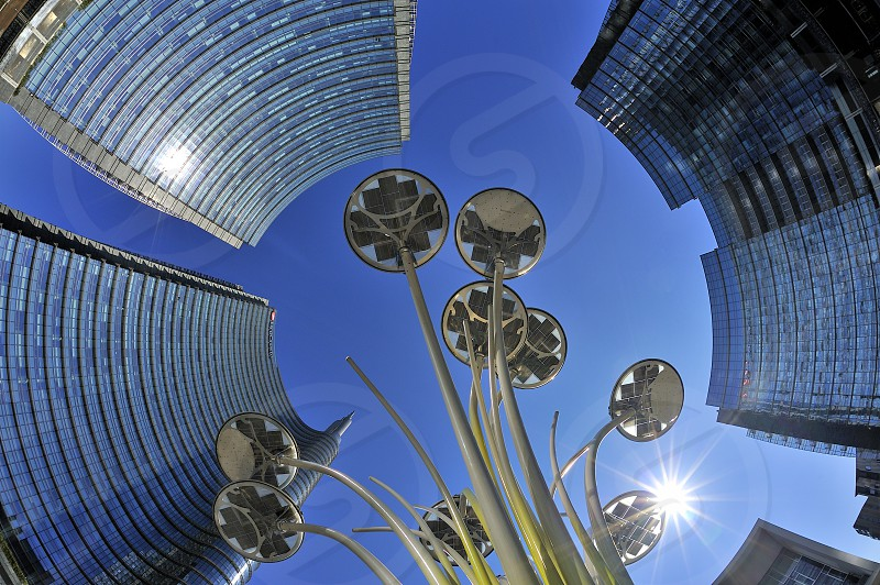 Fisheye view of Gae Aulenti Square in Porta Nuova district Milano Italy with sun shining over LED lamps photo