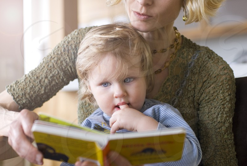 MOTHER READING TO SON photo