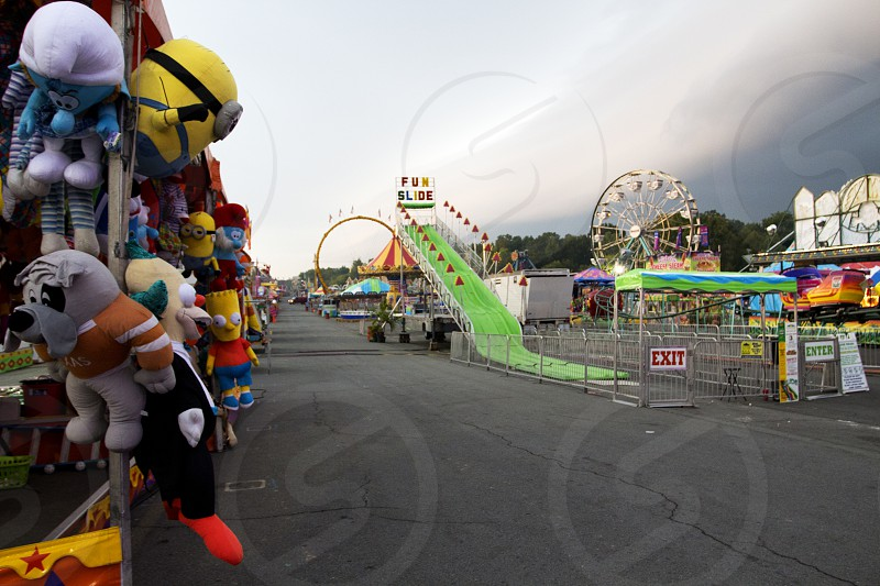 Fair or festival midway with fun slide and stuffed animals photo
