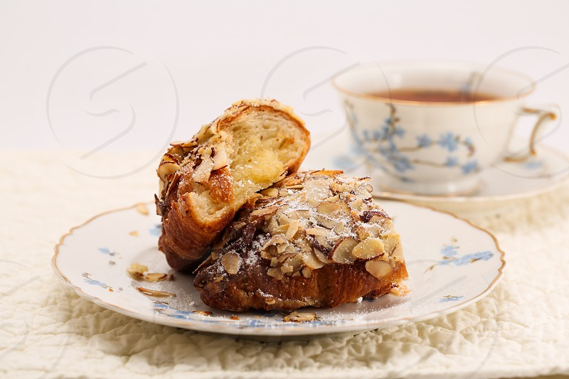 almond croissant and cup of tea photo