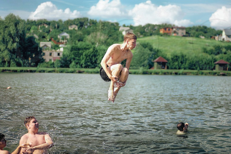 tennagers have fun in a lake at summer photo