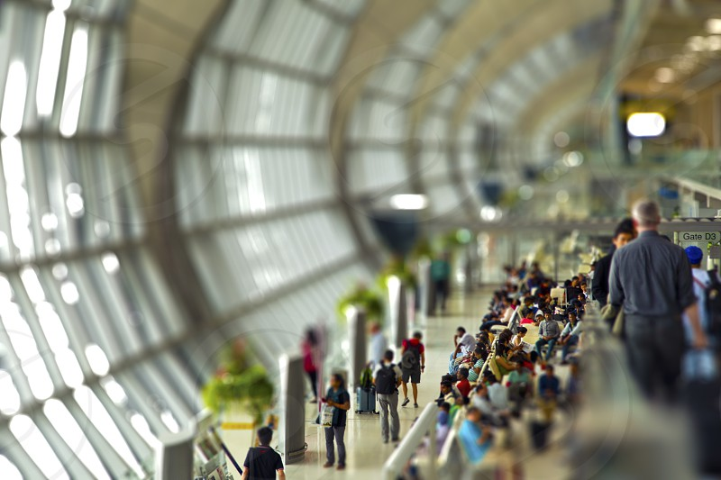 Queuing at the aiport passenger waiting for boarding. edited tilt-shift effect photo